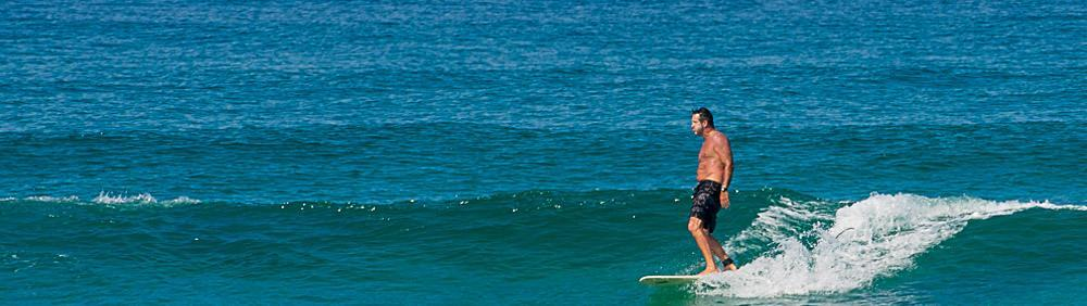 Longboarder summer surfing in South West Frnace with Natural Surf Lodge
